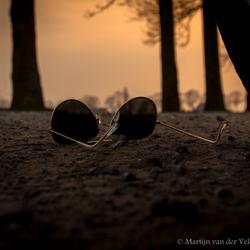 Sunglasses down