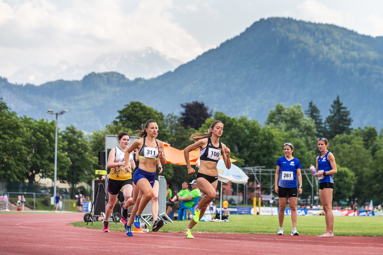 Running ECSG'19 - Multiple athletes running the 400m during the European Company Sport Games in Salzburg with the Untersberg-Plateau in the background
