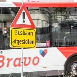 Toeval met langsrijdende bus.