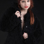 redhead in a black coat