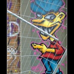graffiti behind fence