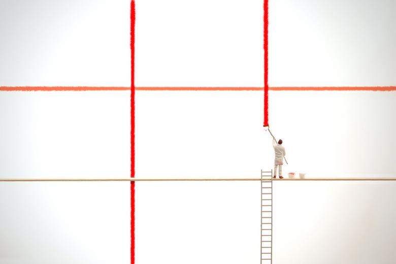 de wet der derden - Deze schilder is bezig een raster te schilderen om de compositieregel wet der derden te kunnen uitleggen.