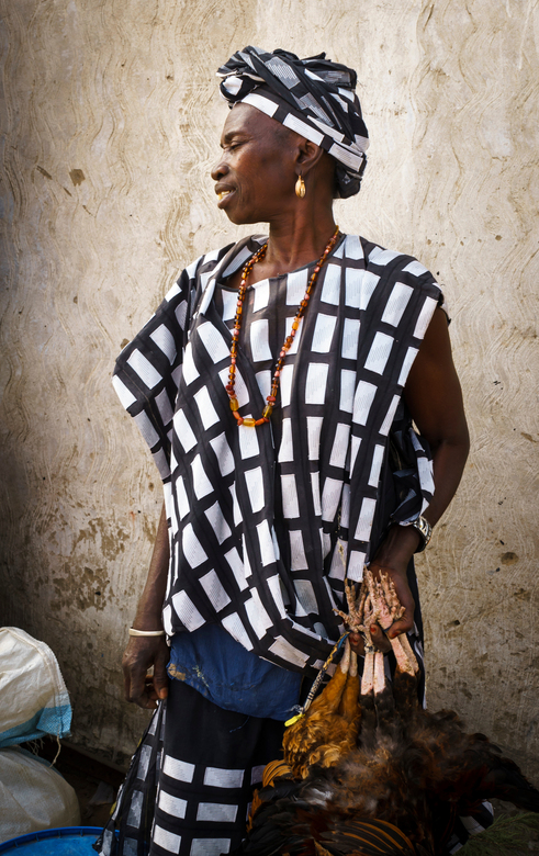 Proud African woman - Proud African woman in traditional dress selling chickens at the market.