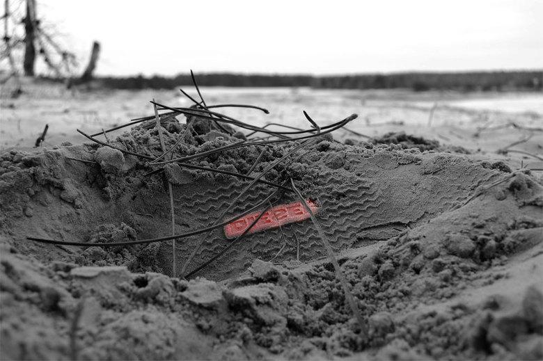 Diesel - Schoenafdruk in het zand op de drunese duinen.