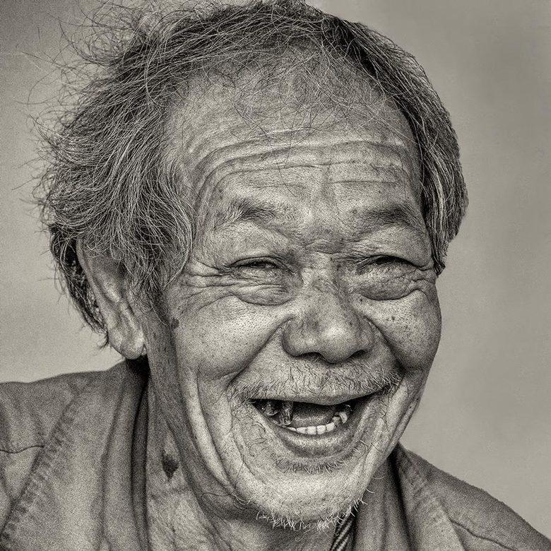 Alweer een blijde Chinees in Beijing - Alweer een blijde Chinese man, ook weer in Beijing. Nu in de oude binnenstad van Beijing.<br /> <br /> Meer f