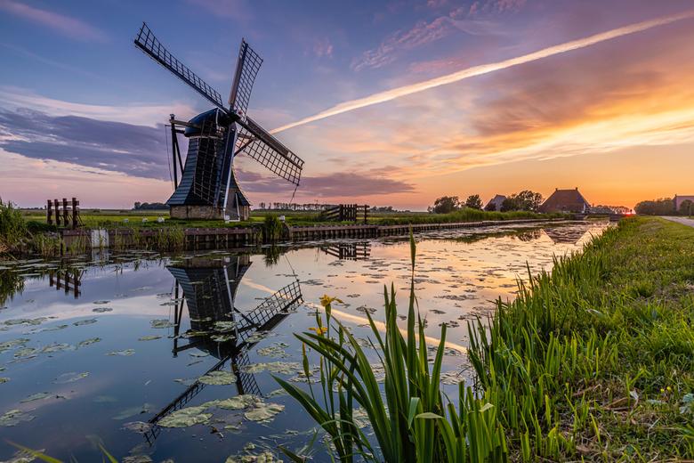 workum windmill - windmill close to workum at sunset