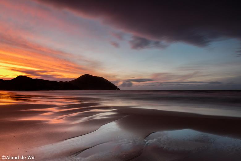 Wharariki Beach - Zonsondergang Wharariki Beach, South Island, New Zealand.<br /> <br /> Iso 50<br /> F11<br /> 25 seconde<br /> 24mm<br /> <br