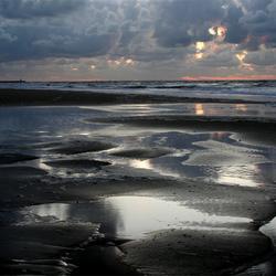 zonsondergang op t strand