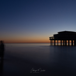 Pier at sunset-dark mood