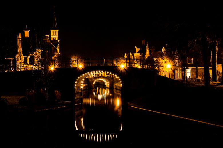 Het kleinste Friese Stadje - Sloten - De kleinste Friese stad, één van de elf steden van de 11-stedentocht. Hier een landschap foto bij avond van dit