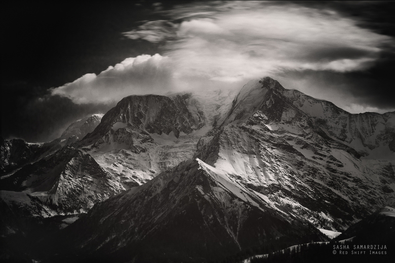 Peaks and clouds - Clouds over distant mountain peaks and glaciers  in French Alps, Mont Blanc area, Chamonix, Saint Gervais.