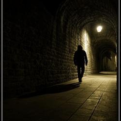 Walking in an alley.