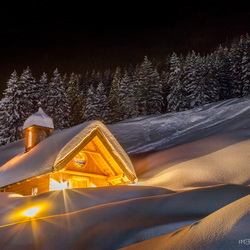 Little lovely church in the snow