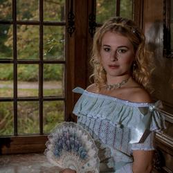 Renata next to the window