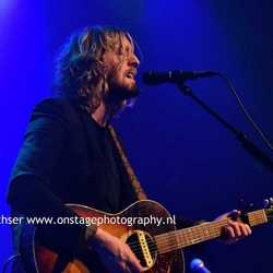 Singer songwriter Andy burrows in Blue