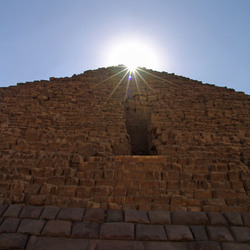 Sun light (Ra) above the pyramid of Gizeh