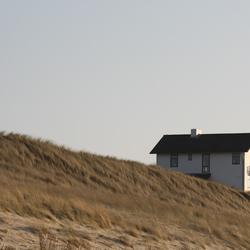Klein huisje aan het strand