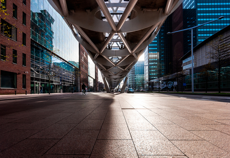 Shadows and Stockings v1 - The financial District of Beatrixkwartier in The Hague, The Netherlands. Modern tall buildings surround the futuristic arch