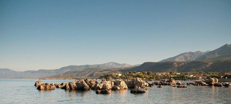 Genieten van het ochtendlicht - In alle vroegte een wandeling langs de kust, nog geen toerist te bekennen.
