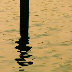 Paal in het water