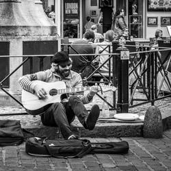De straatmuzikant