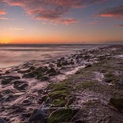 zonsondergang met laag water