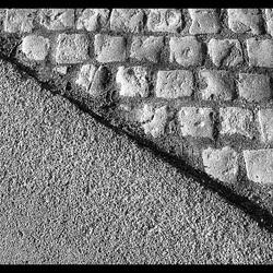 Asphalt and paving stones.