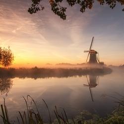 Foggy sunrise near the windmill