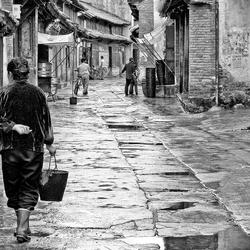 straatbeeld China na een regenbui