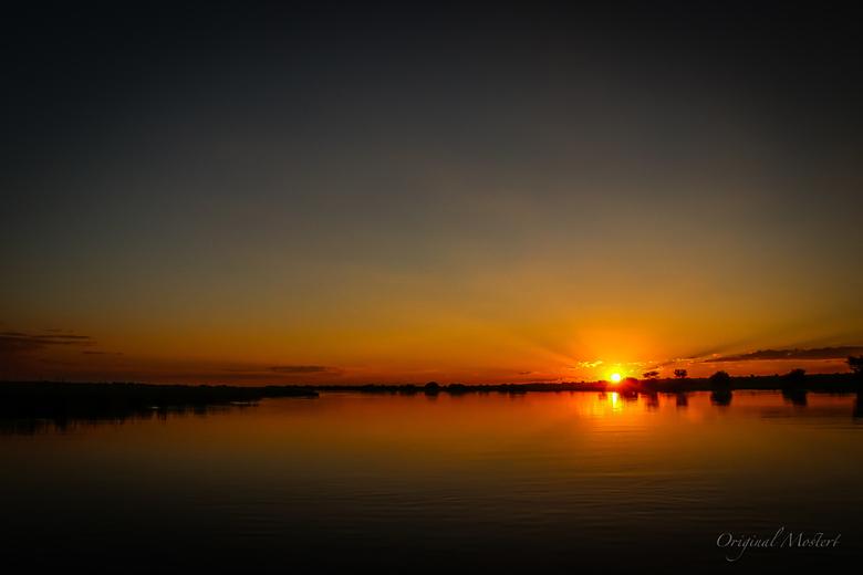 Sunset, Okavango Rivier in Namibie