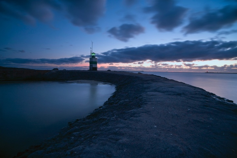 Rifkin Lighthouse in Blue-hours - This is a long exposure during blue hours. It is the first lighthouse you see on the peer of IJmuiden, in Netherland