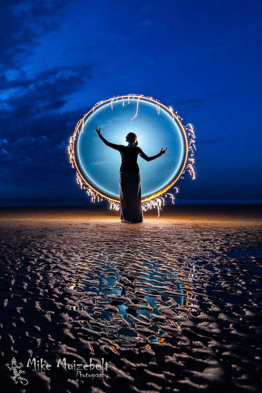 Ring of fire - Je compositie bepaald mede de kracht van je foto, in dit geval werkte een staande foto het beste om de reflectie te benadrukken.