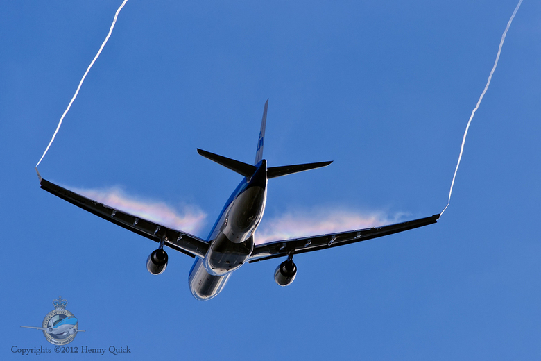 Up in the sky - KLM A330 with rainbow-condensation and vortex