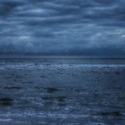 Zee, lucht en surfer