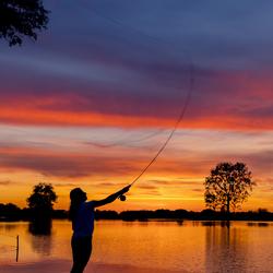 Vliegvissen bij zonsondergang