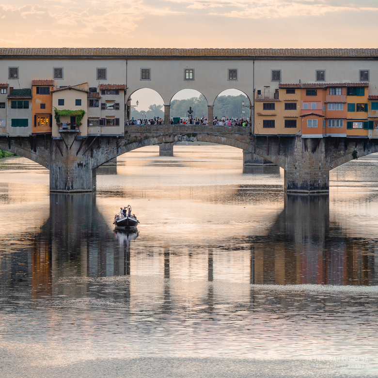 "Bridge Ponte del Vecchio in Florence - Bridge Ponte del Vecchio (&quot;Old Bridge&quot<img  src=""/images/smileys/wilt.png""/> over Arno river, boat und"