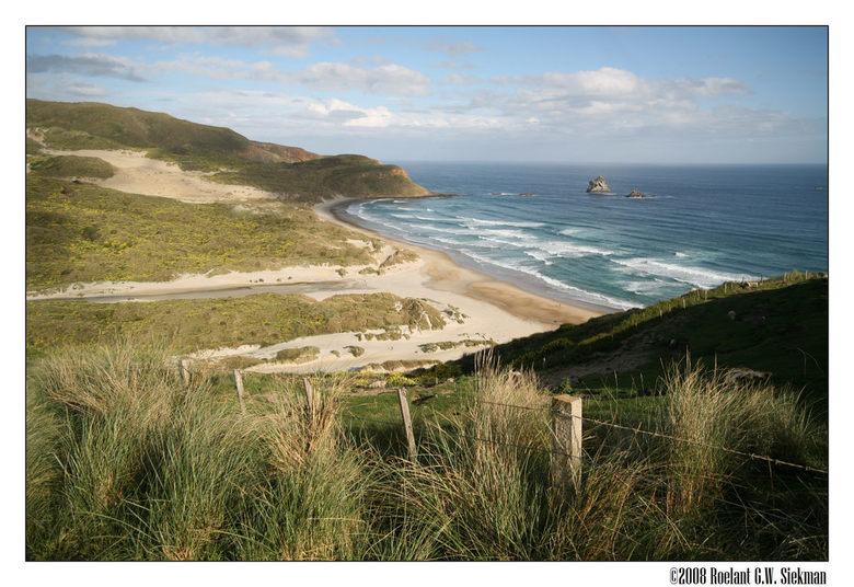 Zoom in! - Sandfly Bay is een strand vlak bij Dunedin, op het Zuider eiland van New Zealand.<br /> <br /> Vanaf dit punt had je zo&#039;n mooi overz
