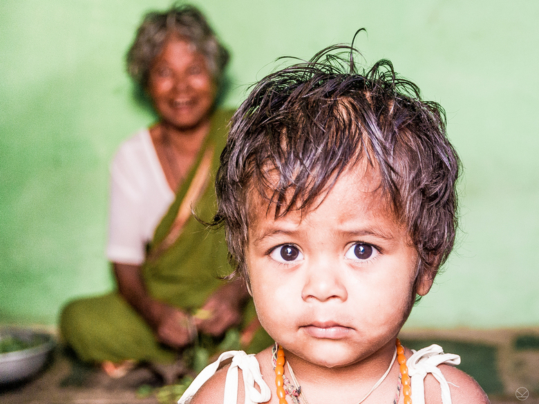 Curiostiy overwins insecurity.jpg - shot in India, hospet. Whilst wandering around this lovely family was hidden at the corner of dusty main road, and