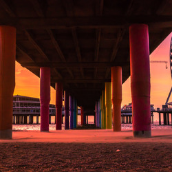 scheveningse pier tijdens zonsondergang