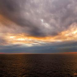 Zee, zon en wolken