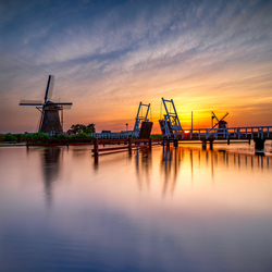 Windmill and drawbridge at sunset
