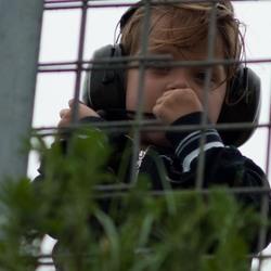 little boy watching F1