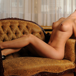 Naked woman on sofa