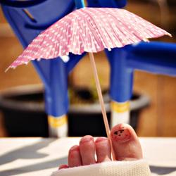 onder moeders parasol