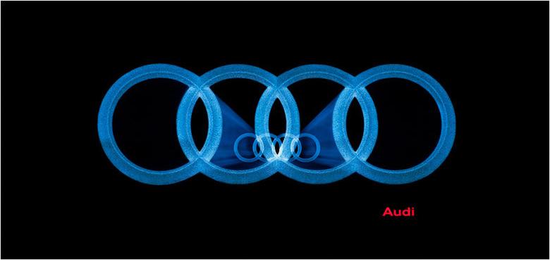 Audi logo 2011 !!! - Onlangs aan het experimenteren geweest met het Audi logo op de gevel van een garage.<br /> <br /> Zou dit het nieuwe Audi logo