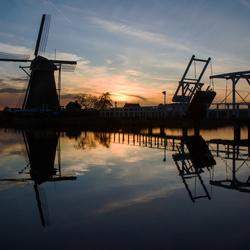 Bezoekmolen SWEK Kinderdijk bij zonsondergang