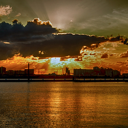zon onder boven het IJ