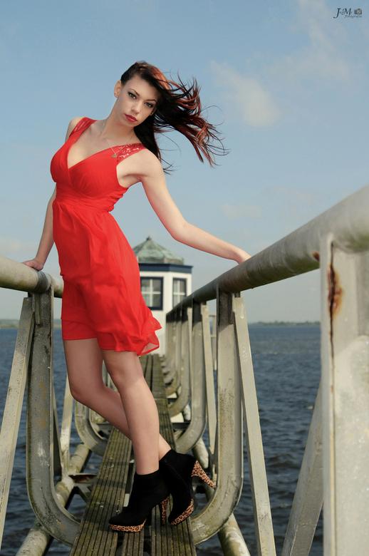 Girl in red dress posing in the wind - Model: Harmke van der Meer<br /> <br /> Shootdate: 13-9-2014<br /> Schootlocation: Oostmahorn