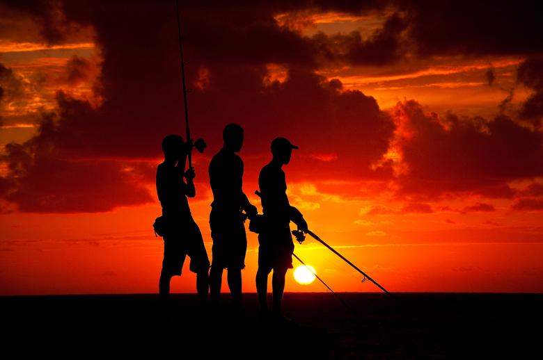 VIsser in havana - VIssers in Havana tijdens zonsondergang