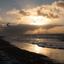 Kite surfen bij zonsondergang